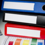 Multicolored binders in stack: SBDPro Business Articles Blog