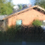 Heavy rain with house in distance: SBDPro Small Business Blog