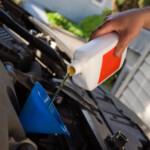 Man changing oil: SBDPro General Auto Info Blog