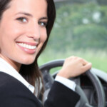 Woman in suit driving car: SBDPro Automotive Blog