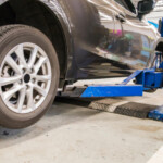 mechanic rotating tires, SBDPro Automotive Article