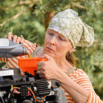 woman adds oil to engine: SBDPro Automotive Articles