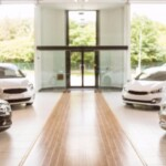 row of new cars in showroom