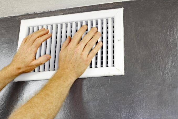 man closing a vent