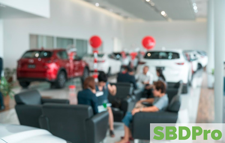Image of the inside of a car dealership lobby